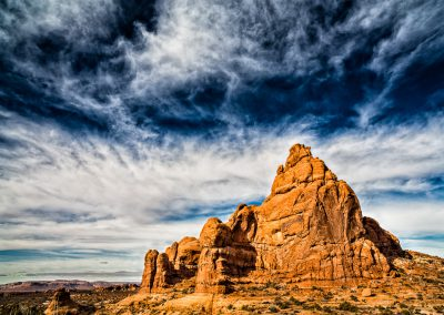 Scale - A formation in Arches National Park basks in the morning sun. Image by Jon Armstrong. | Blurbomat.com