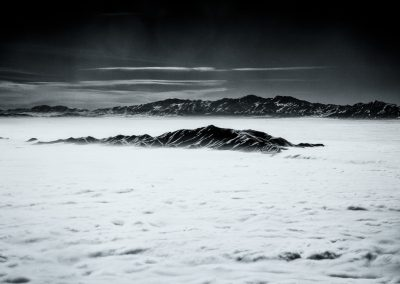 Antelope Island Inversion - On approach to SLC over the Great Salt Lake, Antelope Island peeks out through the inversion. The air above the clouds is warmer than the ground surface. | Blurbomat.com