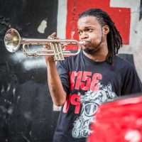 Rise Up Street musician playing trumpet in New Orleans | Blurbomat.com