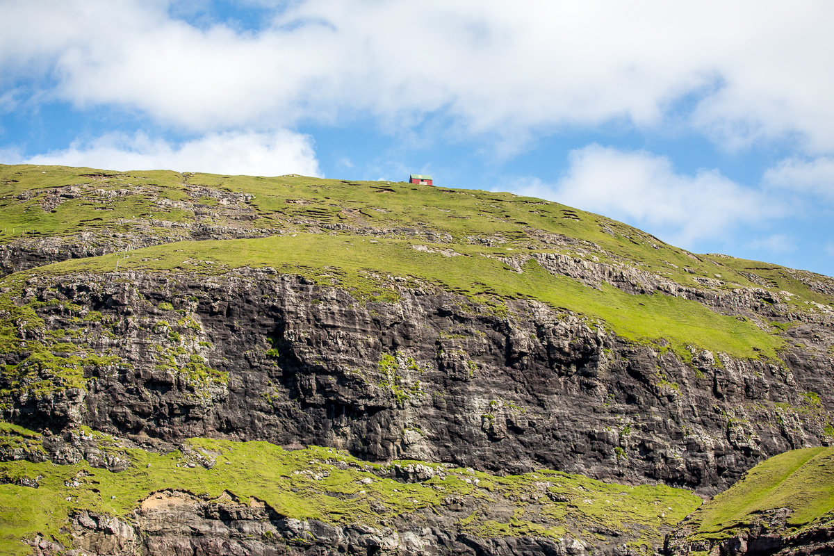 Lone Barn atop a bluff near Vestmanna, Faroe Islands - Blurbomat.com