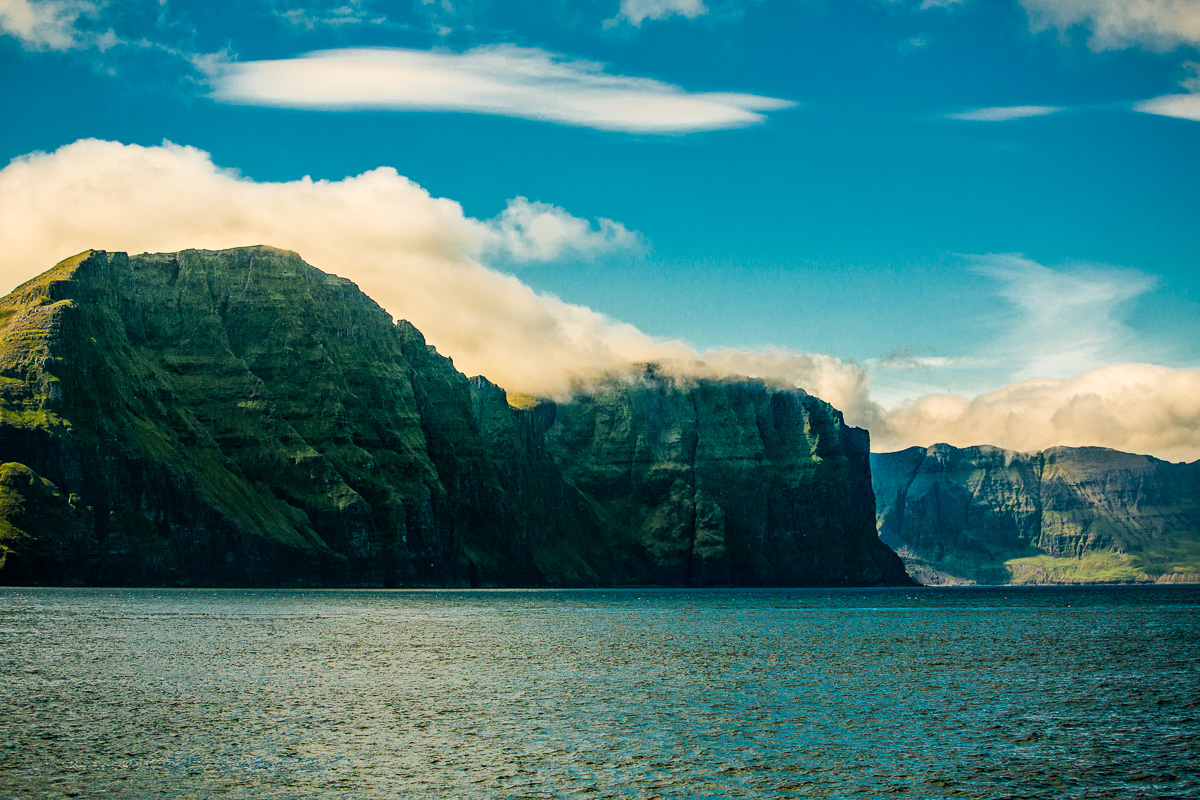 Clouds hugging the landscape near Vestmanna, Faroe Islands - Blurbomat.com