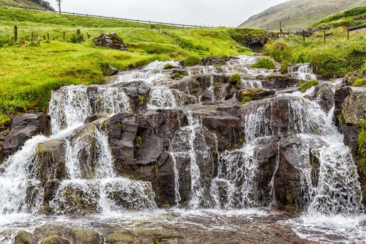 Waterfall just outside of Sandavágur, Faroe Islands. by Jon Armstrong for Blurbomat.com.