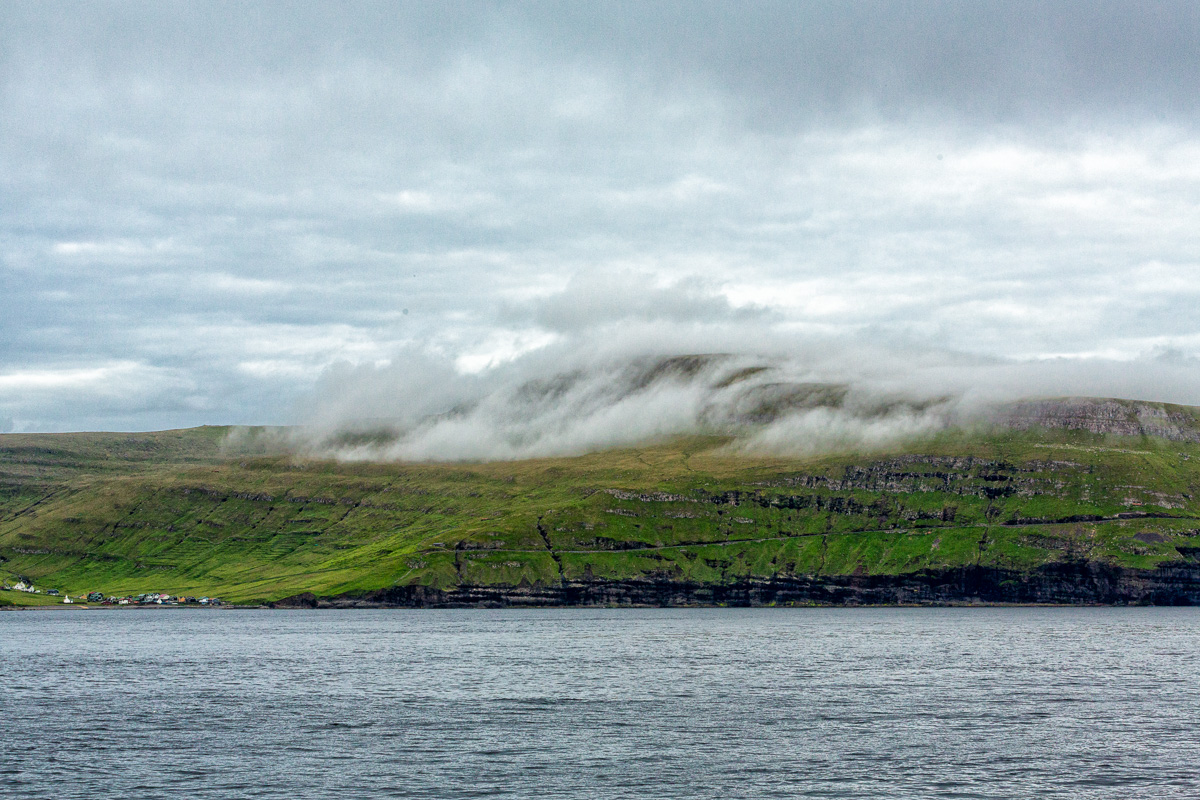 Clouds hovering close. Shot from the deck of the ferry to Suðuroy, Faroe Islands by Jon Armstrong for Blurbomat.com.