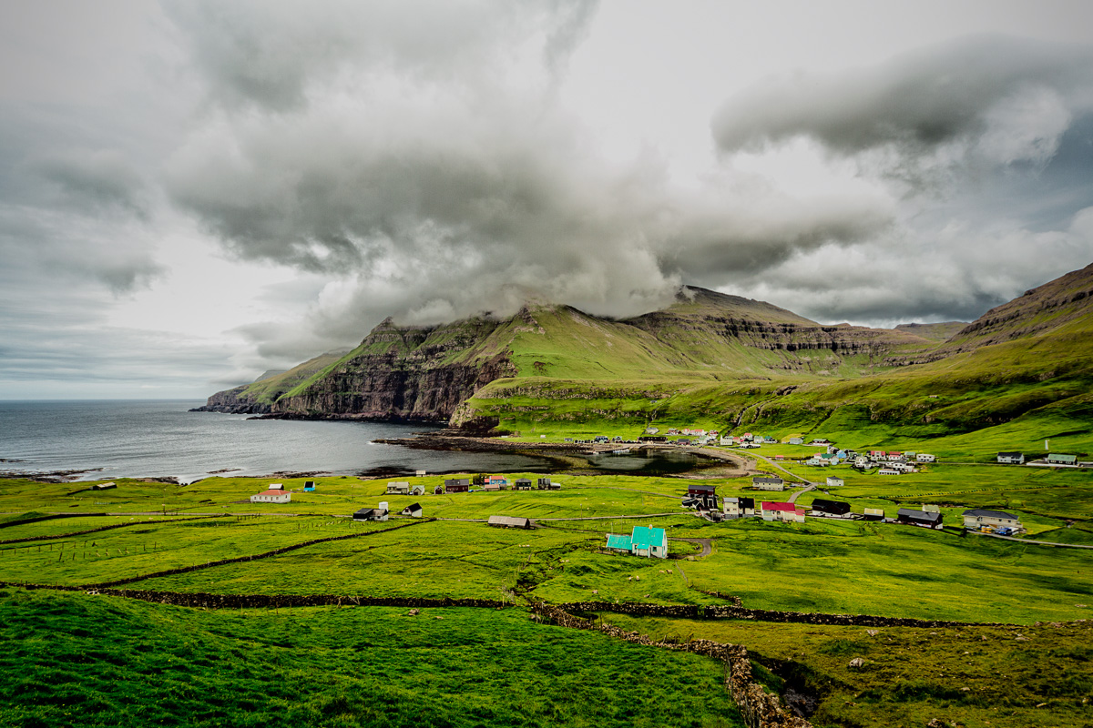 Clouds envelope the mountain top on Suduroy, Faroe Islands.