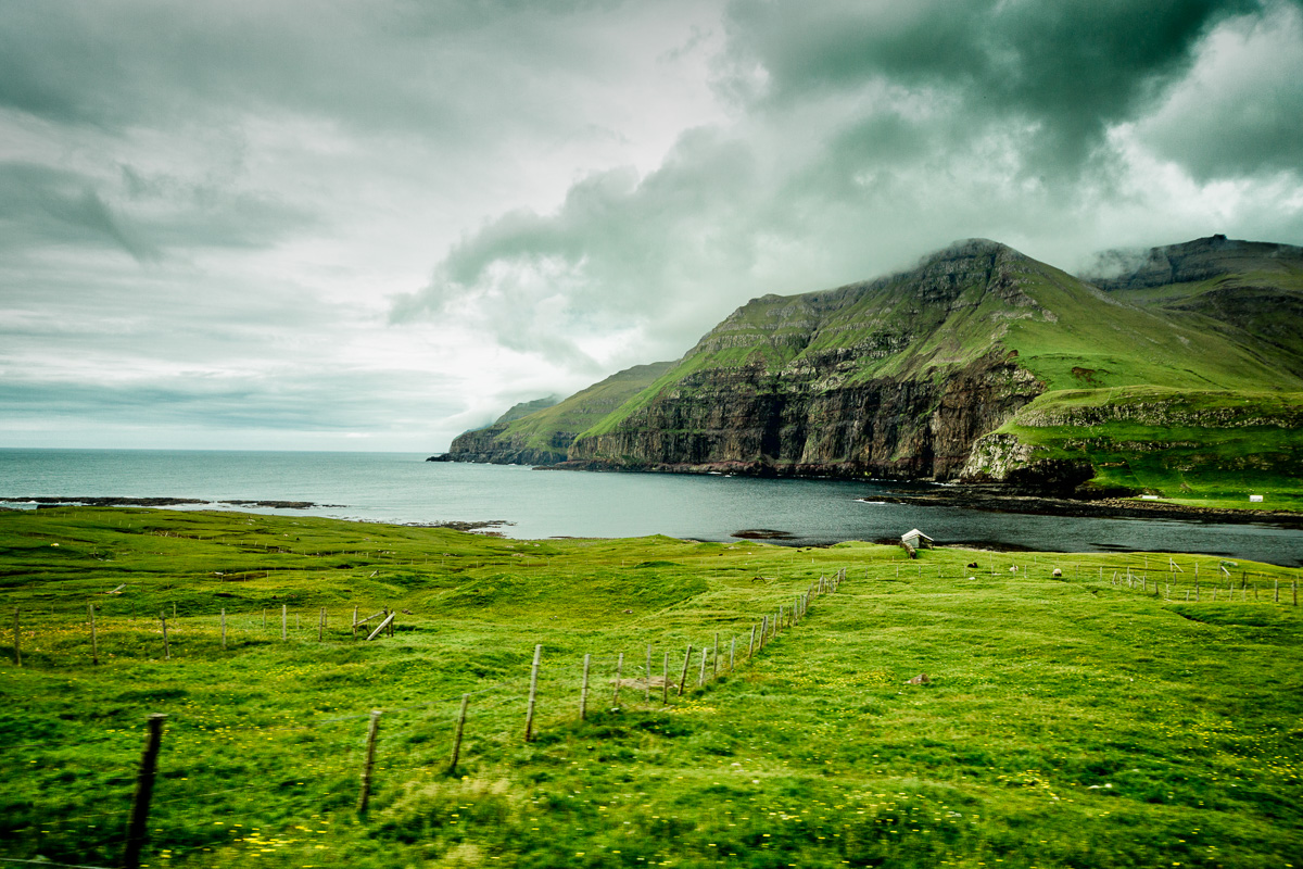 Taken from the back of a moving car on Suduroy, Faroe Islands.