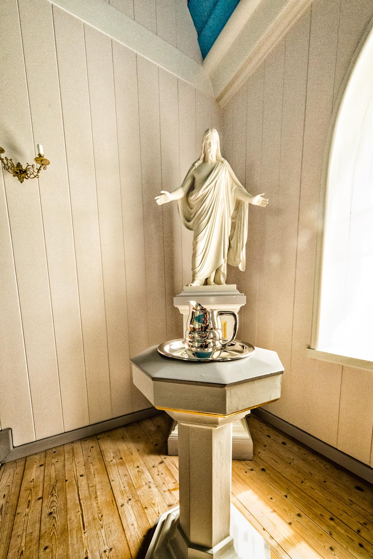 "State church statue, ""Christus"" behind the baptismal font. Fámjin, Suduroy, Faroe Islands."