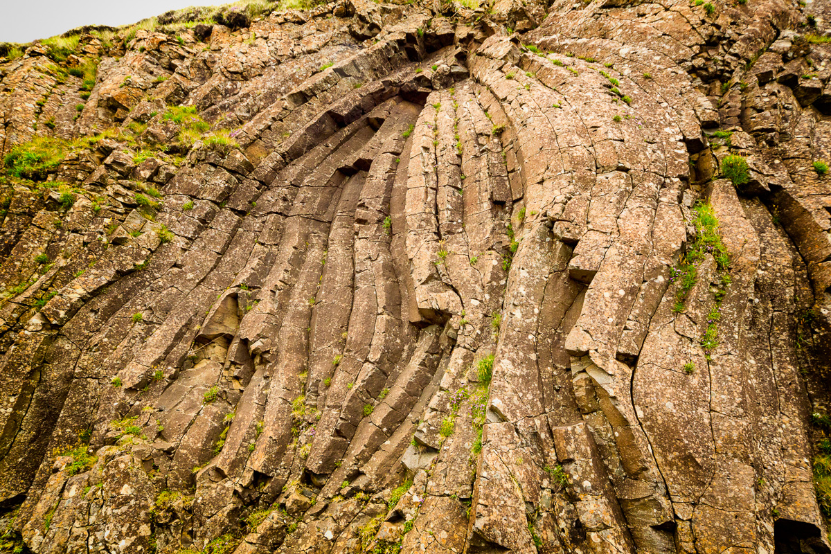 You can see the compression in the stone on Suduroy, Faroe Islands.