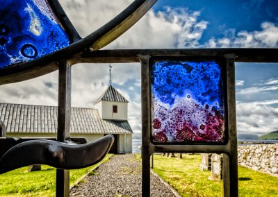 Modern, almost impressionistic stained glass panel in the church gate at Olav's Church, Kirkjubøur. | shot by Jon Armstrong for Blurbomat.com