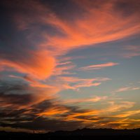 Orange sunset clouds stretch for miles over Salt Lake City. | Jon Armstrong for Blurbomat.com